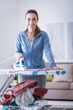 Woman ironing at home royalty free stock photos