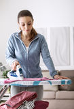 Woman ironing at home Stock Photo