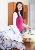 Woman ironing at  home Royalty Free Stock Image
