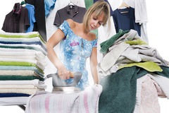 Woman ironing on ironing board many clothes Stock Photo