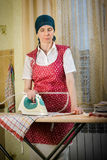 Woman Ironing in the Kitchen Royalty Free Stock Photos