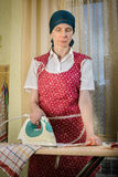 Woman Ironing in the Kitchen Royalty Free Stock Images