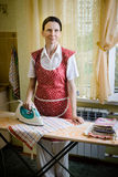 Woman Ironing in the Kitchen Stock Photo