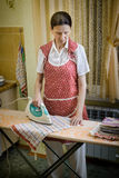 Woman Ironing in the Kitchen Stock Photos