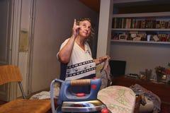 Woman ironing Royalty Free Stock Photos