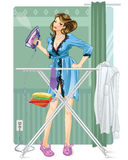 Woman Ironing. Modern house wife irons clothes Stock Image