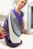 Woman ironing Stock Images
