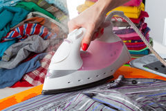 Woman ironing a shirt Royalty Free Stock Photo