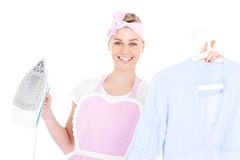 Woman ironing a shirt Stock Images