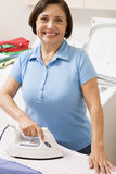 Woman Ironing Shirt Stock Photography
