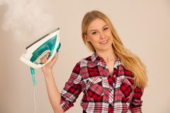 Woman ironing studio photo over white background.  royalty free stock photos