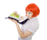 Woman ironing tie Stock Photo