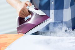 Woman during ironing time Royalty Free Stock Photo