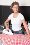 Woman ironing Royalty Free Stock Image