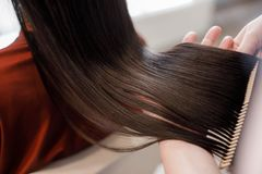 Free Woman Is Coming For Hair Styling To Beauty Salon Stock Photography - 129381632