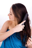 Woman Is Grooming Her Hair Stock Photos