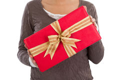 Woman isolated is holding a red christmas present Royalty Free Stock Photo