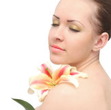 Woman isolated with lily flower. Beautiful woman isolated on white background with a lily flower Royalty Free Stock Photo