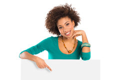 Woman Pointing On Billboard. Woman Isolated Pointing On Billboard Over White Background stock photo
