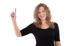 Woman isolated on white in a black shirt with finger pointing Royalty Free Stock Photos