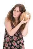 Woman isolated in white with a marine conch Royalty Free Stock Images