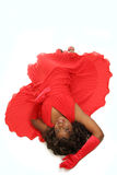 Woman isolated on white in red dress. Laid back on white beautiful woman in red dress and gloves Royalty Free Stock Images