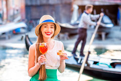 Woman with italian aperitif near the water chanal in Venice Royalty Free Stock Photos