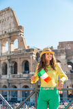 Woman with italian flag in front of colosseum Royalty Free Stock Image
