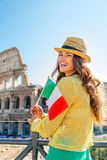 Woman with italian flag in front of colosseum Royalty Free Stock Photography