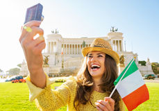 Woman with italian flag making selfie in rome Stock Image