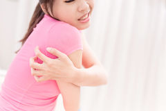 Woman with itchy skin Royalty Free Stock Photos