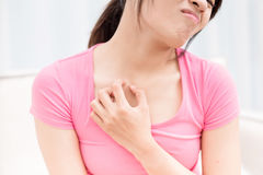 Woman with itchy skin. Problem on the chest in room Royalty Free Stock Photo
