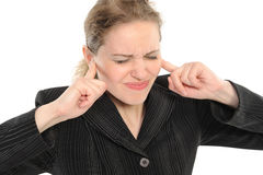 Woman with  its fingers covering his ears Stock Images