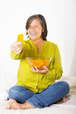 Woman iwth potato chips Stock Images