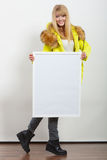 Woman in jacket with blank empty board banner. Stock Photo