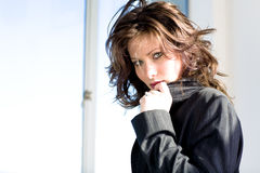 Woman in Jacket, Facing Camera. A young woman wearing a black jacket, facing the camera Stock Photos