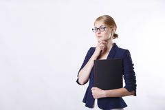 Woman in jacket  with glasses thinking Royalty Free Stock Images