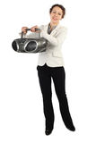 Woman in jacket holding tape recorder and smiling Stock Photography