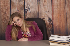 Woman jacket office books bored Royalty Free Stock Images