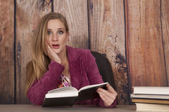Woman jacket office books shock Stock Photo