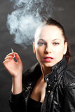 Woman In Jacket Smoking Royalty Free Stock Images