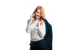 Woman in jacket talking on the phone Royalty Free Stock Images
