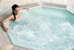 Woman in jacuzzi. Young beautiful woman in jacuzzi stock photos