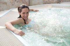 Woman in jacuzzi. Young beautiful woman in jacuzzi stock photography