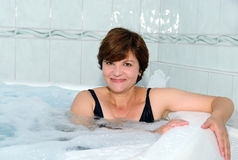 Woman in a jacuzzi Stock Photography