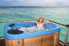 Woman in jacuzzi on background of ocean Stock Image