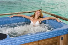Woman in jacuzzi on background of ocean Stock Photography