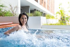 Woman is in jacuzzi pool Stock Photos