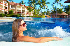 Woman in jacuzzi. Woman relaxing in jacuzzi. Vacation at caribbean resort royalty free stock photography