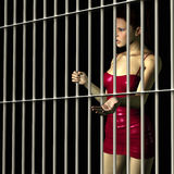 Woman In Jail. Woman Gripping Bars In Prison Cell Royalty Free Stock Image